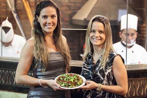 Isadora Fadul e Fernanda Neiva firmaram parceria para oferecer pizzas light, como a de rúcula, tomate seco e muçarela (Vinícius Santa Rosa/Divulgação)