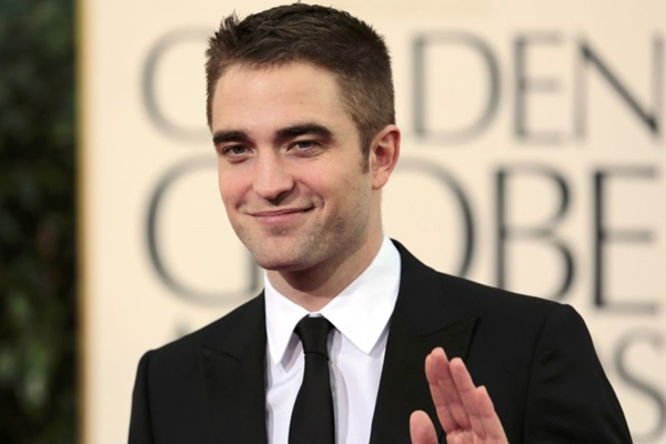'E.L. James e eu estávamos na casa de Rob Pattinson quando ela admitiu que ele era a primeira escolha para Christian', declarou o escritor (REUTERS/Jason Redmond)
