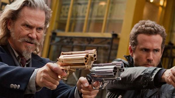 Roy (Jeff Bridges) e Nick (Ryan Reynolds): aventura nos moldes de Homens de preto  (Universal/Divulgação)