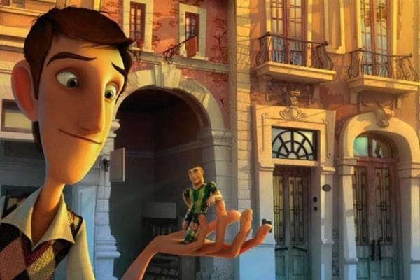 Amadeu, segurando o colega de time Capi: bonecos do pebolim viram jogadores de verdade   (Universal Pictures/Divulgação)