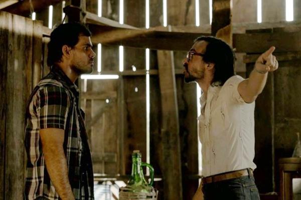 Juliano Cazarr� e Julio Andrade em cena do filme Serra Pelada  (Warner Bros/Divulga��o)