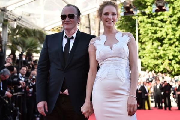 Quentin Tarantino e Uma Thurman chegaram juntos à cerimônia de encerramento do Festival de Cannes, no último dia 24; casal vive, segundo a fonte, em uma relação instável de muitos anos (AFP PHOTO/Divulgação)