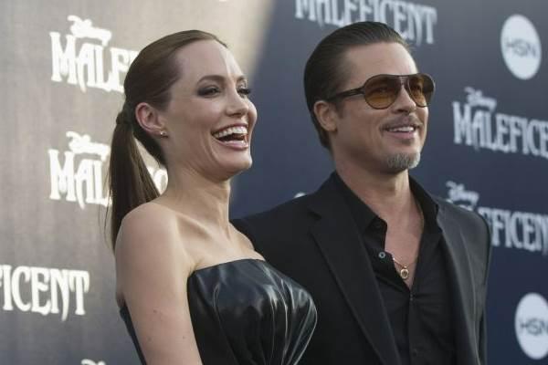 O casal está na China divulgando o filme 'Malévola' (Mario Anzuoni/Reuters)