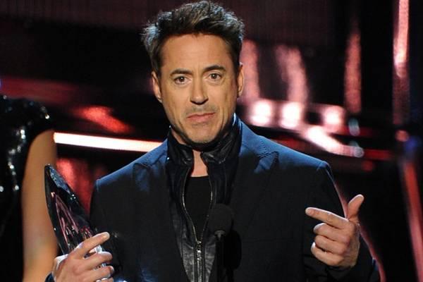 Robert Downey Jr interpreta o super-herói 'Homem de Ferro' nos cinemas (Kevin Winter/Getty Images/AFP)