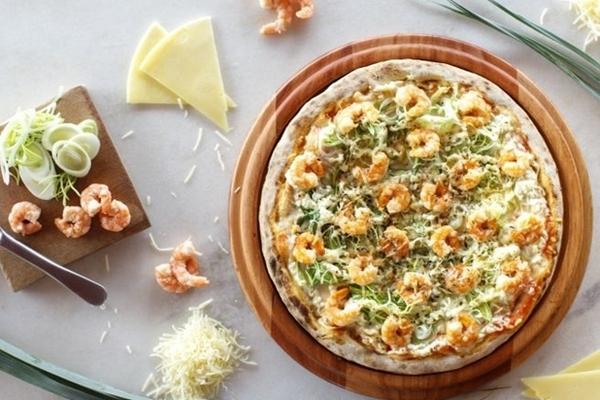 Sabores que fogem do tradicional são a marca da pizzaria Vila Madalena (Vila Madalena pizzaria/Divulgação )